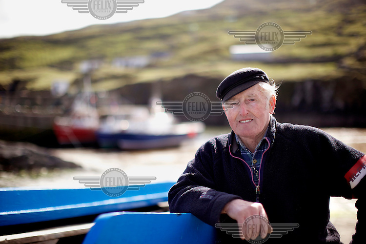 John Concannon, a fisherman and Currach builder. The Currach is an ancient design of boat that consists of a wooden frame, over which animal skins or hide is stretched, though now canvas is more usual.