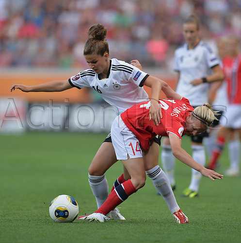17.07.2013. Kalmar, Sweden.  Melanie Leupolz (l) of Germany challenges for the ball with Gry Tofte Ims from Norway during the UEFA Women's EURO 2013 Group B soccer match between Germany and Norway at the Kalmar Arena in Kalmar, Sweden, 17 July 2013.