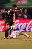 Venezuela midfielder Tomas Rincon (8) slide tackles Mexico forward Giovani Dos Santos (10). The national teams of Mexico and Venezuela played to a 1-1 draw in an International friendly match at  Qualcomm stadium in San Diego, California on  March 29, 2011...