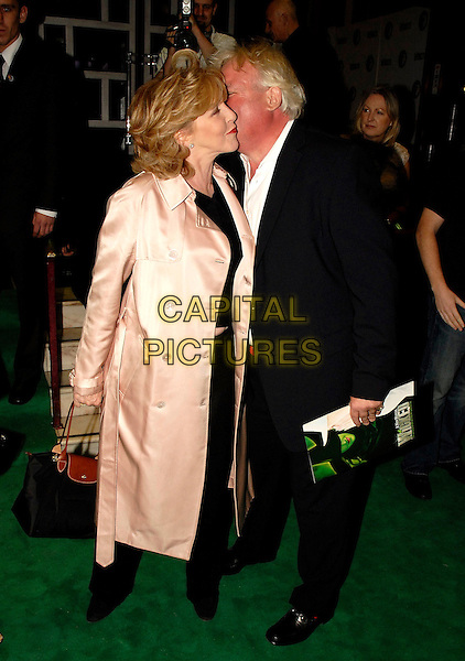 "PATRICIA HODGE & GUEST.Opening night of ""Wicked: The Untold Story of The Witches Of Oz"" at Apollo Victoria Theatre, London, UK. .September 27th, 2006.Ref: SW.full length pink satin coat profile kiss black suit jacket.www.capitalpictures.com.sales@capitalpictures.com.©Stephen Walters/Capital Pictures."