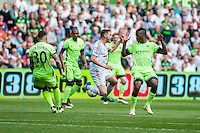 Angel Rangel of Swansea City  is brought down by Nicolas Otamendi of Manchester City during the Barclays Premier League match between Swansea City and Manchester City played at the Liberty Stadium, Swansea on the 15th of May  2016