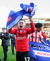 Lincoln City's Shay McCartan celebrate after securing promotion from Sky Bet League Two<br /> <br /> Photographer Chris Vaughan/CameraSport<br /> <br /> The EFL Sky Bet League Two - Lincoln City v Cheltenham Town - Saturday 13th April 2019 - Sincil Bank - Lincoln<br /> <br /> World Copyright © 2019 CameraSport. All rights reserved. 43 Linden Ave. Countesthorpe. Leicester. England. LE8 5PG - Tel: +44 (0) 116 277 4147 - admin@camerasport.com - www.camerasport.com