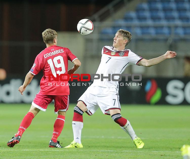 EM 2015 Qualifikationsspiel, Gibraltar vs. Deutschland<br /> James Coombes (Gibraltar), Bastian Schweinsteiger (Deutschland)<br /> <br /> <br /> Foto &copy; nordphoto /  Bratic