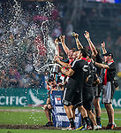 New Zealand players celebrate with the trophy after winning the Cup Final during the Cathay Pacific / HSBC Hong Kong Sevens at the Hong Kong Stadium on 30 March 2014 in Hong Kong, China. Photo by Andy Jones / Power Sport Images