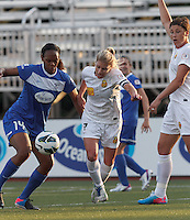 Boston Breakers defender Kia McNeill (14) and Western New York Flash midfielder McCall Zerboni (7) battle for the ball. In a National Women's Soccer League Elite (NWSL) match, the Boston Breakers (blue) tied Western New York Flash (white), 2-2, at Dilboy Stadium on June 5, 2013.