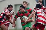 Ra Garmonsway charges towards the tryline between Siale Piutau & George Crichton. Counties Manukau Premier Club Rugby game between Waiuku & Karaka played at Waiuku on Saturday July 4th 2009. Waiuku won the game 22 - 7.
