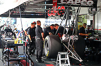 Jul. 27, 2014; Sonoma, CA, USA; Crew members work on the engine of NHRA top fuel driver Steve Torrence during the Sonoma Nationals at Sonoma Raceway. Mandatory Credit: Mark J. Rebilas-