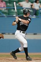 Mike Hofius of the Long Beach State Dirtbags bats during a 2002 season NCAA game at Blair Field in Long Beach, California. (Larry Goren/Four Seam Images)