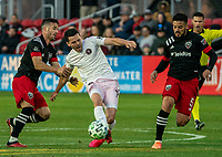 WASHINGTON, DC - MARCH 07: Felipe Martins #18 of DC United stops Lewis Morgan #7 of Inter Miami during a game between Inter Miami CF and D.C. United at Audi Field on March 07, 2020 in Washington, DC.