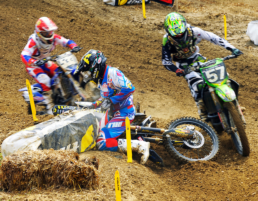 A downed rider is passed by other racers in the  250 class during the first moto of the Lucas Oil AMA Pro Motocross at Budds Creek National in Mechanicsville, Maryland on Saturday, June 18, 2011. Alan P. Santos/DC Sports Box