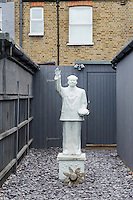 In the back garden stands a sculpture of Chairman Mao brought from Shanghai.