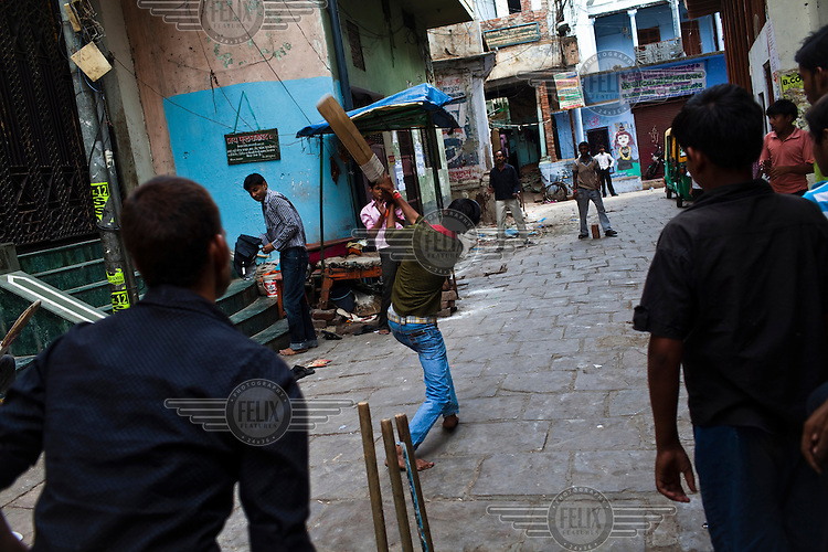 Young men play cricket in the narrow alleys in the ancient city of Varanasi.