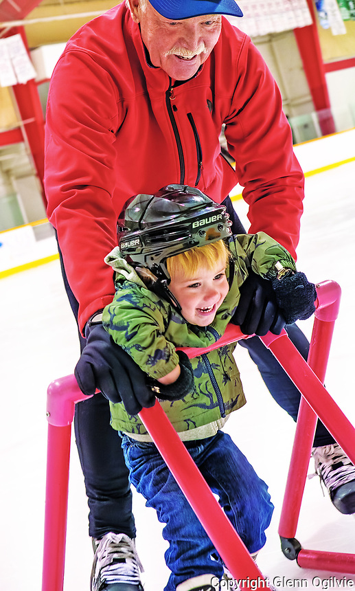 """Steve Hicken, of Sarnia with his two-year-old grandson Keaton a.k.a.""""Buster"""" Garvin.<br /> <br /> Hicken said he played a lot of local hockey when he was young including pick-up hockey and some travel as well. <br /> <br /> """"I have four grandchildren, three of them girls who don't like hockey. I've tried,""""he said """" Keaton seems to like skating, which is really important to me."""""""
