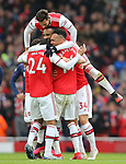 Arsenal's Alexandre Lacazette celebrates with team mates after scoring the opening goal during the Premier League match at the Emirates Stadium, London. Picture date: 7th March 2020. Picture credit should read: Paul Terry/Sportimage