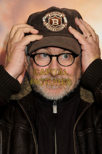 "STEVEN SPEILBERG .""The Lovely Bones"" Los Angeles Premiere held at Grauman's Chinese Theatre, Hollywood, California, USA, .7th December 2009..portrait headshot cap hat glasses brown jacket beard facial hair collar hands on touching head funny .CAP/ADM/BP.©Byron Purvis/Admedia/Capital Pictures"