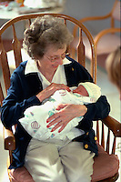Great grandmother age 85 holding newborn grandson after birth.  Edina Minnesota USA