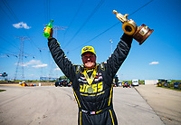 Jun 3, 2018; Joliet, IL, USA; NHRA pro stock driver Jeg Coughlin Jr celebrates after winning the Route 66 Nationals at Route 66 Raceway. Mandatory Credit: Mark J. Rebilas-USA TODAY Sports