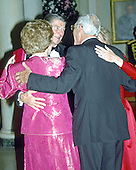United States President Ronald Reagan and Prime Minister Margaret Thatcher of Great Britain and their spouses embrace after sharing a dance in the Entrance Hall of the the White House in Washington, D.C. following the dinner in her honor on Wednesday, November 16, 1988.  Thatcher died from a stroke at 87 on Monday, April 8, 2013..Credit: Ron Sachs / CNP