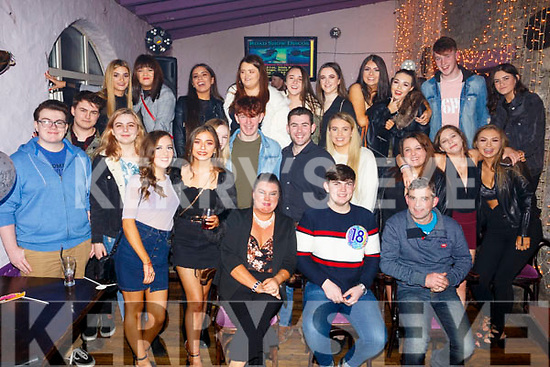 David Broderick , seated front centre, celebrating his 18th Birthday in the Greyhound bar with family and friends on Saturday night last. Seated l-r, Belinda, David and John Broderick.