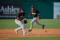 Jupiter Hammerheads third baseman James Nelson (20) fields a ground ball as Jose Devers (1) backs up the play during a Florida State League game against the Dunedin Blue Jays on May 15, 2019 at Jack Russell Memorial Stadium in Clearwater, Florida.  Jupiter defeated Dunedin 5-1 in seven innings, the first game of a doubleheader.  (Mike Janes/Four Seam Images)