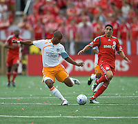 18 July 2009: Toronto FC forward Pablo Vitti #8 stands back as Houston Dynamo defender Julius James #3 clears a ball in a game between the Toronto FC and Houston Dynamo..The game ended in a 1-1 draw..