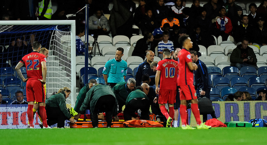 Paramedics preparing a stretcher for Blackburn Rovers' Tommy Spurr, knocked out early in the 1st half<br /> <br /> Photographer Ashley Western/CameraSport<br /> <br /> Football - The Football League Sky Bet Championship - Queens Park Rangers v Blackburn Rovers - Wednesday 16th September 2015 - Loftus Road - London <br /> <br /> &copy; CameraSport - 43 Linden Ave. Countesthorpe. Leicester. England. LE8 5PG - Tel: +44 (0) 116 277 4147 - admin@camerasport.com - www.camerasport.com