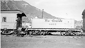 Side view of water car #0465 (ex Unitah) at Durango.  Partial end view of work coach #0292 (operator's car B-6).<br /> D&amp;RGW  Durango, CO  Taken by Maxwell, John W. - 3/30/1959