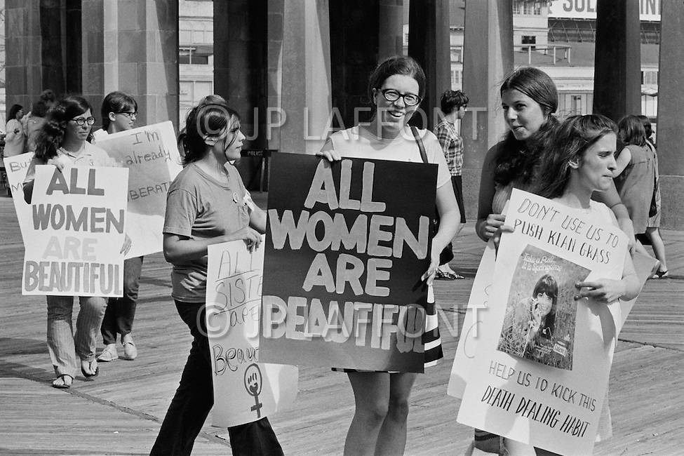 """06 Dec 1969, Atlantic City, New Jersey, USA --- Women's Liberation Movement demonstrators carrying picket signs which state """"All Women are Beautiful"""" in protest against the Miss America pageant in Atlantic City, New Jersey. --- Image by © JP Laffont"""