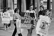 "06 Dec 1969, Atlantic City, New Jersey, USA --- Women's Liberation Movement demonstrators carrying picket signs which state ""All Women are Beautiful"" in protest against the Miss America pageant in Atlantic City, New Jersey. --- Image by © JP Laffont"
