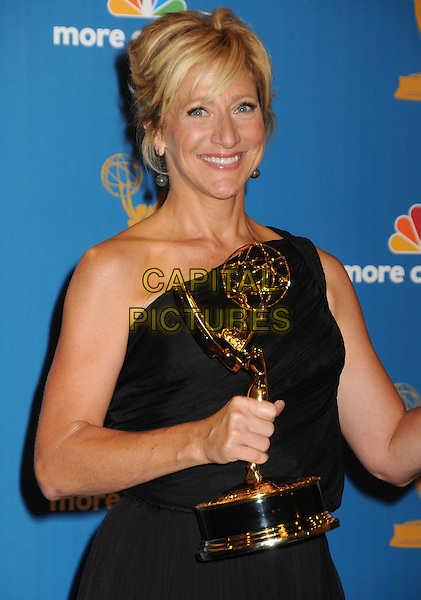 EDIE FALCO.62nd Annual Primetime Emmy Awards held at NOKIA Theatre Los Angeles, California, USA. .29th August 2010.half length trophy winner black one shoulder dress .CAP/ADM/BP.©Byron Purvis/AdMedia/Capital Pictures.