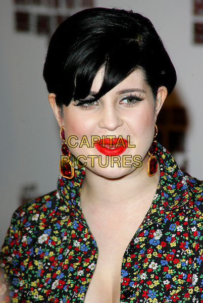 KELLY OSBOURNE.The South Bank Show Awards, The Dorchester Hotel, London, England..January 29th, 2008.headshot portrait red lipstick dangling gold ruby earrings .CAP/ROS.©Steve Ross/Capital Pictures