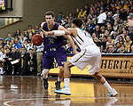 SIOUX FALLS, SD - FEBRUARY 27:  Mack Johnson #3 from the University of Sioux Falls looks to make a move against Jordan Spencer #23 from Augustana during their NSIC Tournament game Saturday night at the Pentagon in Sioux Falls. (Photo by Dave Eggen/Inertia)