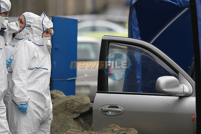 Garda CSI , GSOC and State Pathologist Marie Cassidy attend the scene of the Shooting in Drogheda...Garda in Drogheda backed up by members of the ARU and Armed detectives sealed of an area of the North Quay, North strand area of the town, Pictured is the crime scene unit sealing off an area with a silver Hyundai Santa Fe jeep. It is believed from information at the scene that one male had been fatally shot, no further information at present..Picture: Fran Caffrey/www.newsfile.ie.