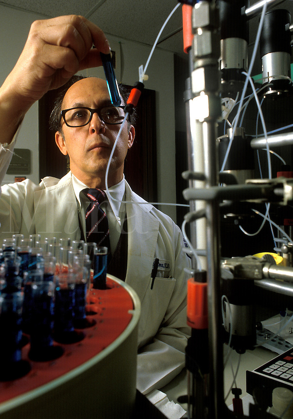 Research scientist conducting an experiment.
