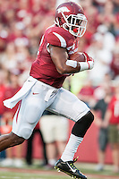 STAFF PHOTO ANTHONY REYES • @NWATONYRArkansas runningback Jonathan Williams (32) escapes a pait of Northern Illinois University tacklers in the first quarter on his way to a touchdown Saturday, Sept. 20, 2014 at Razorback Stadium in Fayetteville.
