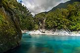 NEW ZEALAND, Hokitika, Woman Crossing the Cesspool Swingbridge over the Arahura River, Ben M Thomas