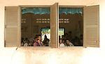 Students at the Kok Thnot Commune Village School, one hour from Siem Reap wait for their class on preventitive eye care. The program is an outreach effort from Angkor Children's Hospital in Siem Reap.