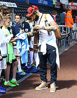 Nicolas Otamendi of Manchester City signs autographs for fans during the Barclays Premier League match between Swansea City and Manchester City played at The Liberty Stadium, Swansea on 15th May 2016