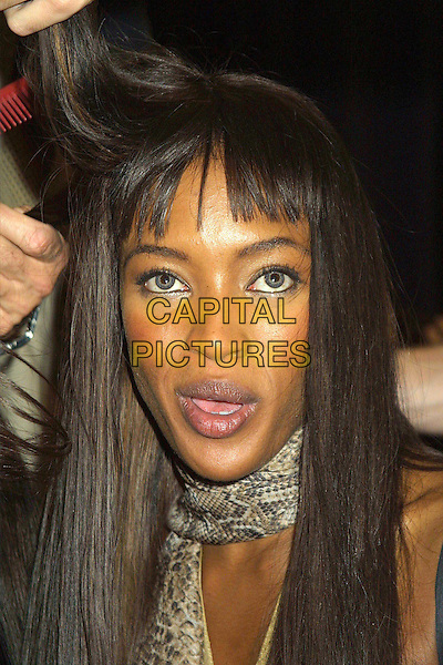 NAOMI CAMPBELL..Backstage at the Anna Sui Fashion Show. ..Ref: IW..fringe, headshot, portrait..www.capitalpictures.com..sales@capitalpictures.com..©Capital Pictures
