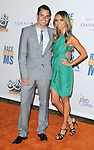 "Giuliana Rancic and husband Bill Rancic arriving at the 16th Annual Race To Erase MS themed ""Rock To  Erase MS"" held at the Hyatt Regency Century Plaza Century City, Ca. May 8, 2009."
