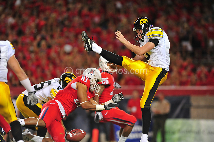 Sept 18, 2010; Tucson, AZ, USA; Iowa Hawkeyes punter Ryan Donahue (5) has his punt blocked by Arizona Wildcats wide receiver David Roberts (81) in the 1st quarter of a game at Arizona Stadium.