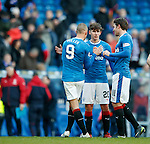 Kenny Miller, Emerson Hyndman and Josh Wndass congratulate one another at time up as Rangers progress to the next round of the Scottish Cup