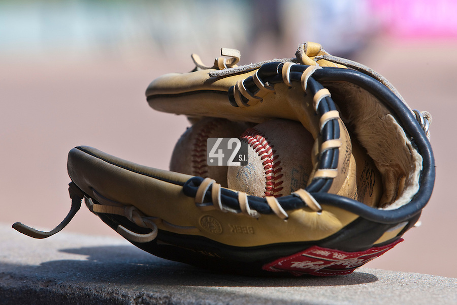 23 May 2009: A glove and balls are seen in the dugout during the 2009 challenge de France, a tournament with the best French baseball teams - all eight elite league clubs - to determine a spot in the European Cup next year, at Montpellier, France. Rouen wins 6-2 over La Guerche.