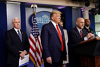 United States President Donald J. Trump, center, and US Vice President Mike Pence, left, listen to Stephen Hahn, Commissioner, US Food and Drug Administration (FDA), center right, speaking during a press briefing on the Coronavirus COVID-19 pandemic with members of the Coronavirus Task Force at the White House in Washington on March 19, 2020. At right is US Surgeon General Vice Admiral (VADM) Jerome M. Adams, M.D., M.P.H.<br /> Credit: Yuri Gripas / Pool via CNP/AdMedia