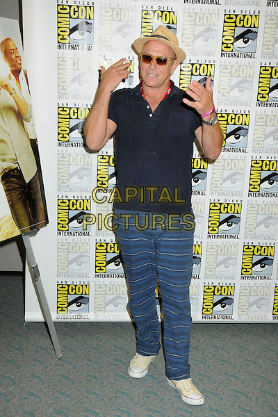 Corbin Bernsen.Comic-Con International 2011 - Day 1 held at The San Diego Convention Center, San Diego, California, USA..July 21st, 2011.full length black top jeans denim hat sunglasses shades striped stripes hands.CAP/ADM/BP.©Byron Purvis/AdMedia/Capital Pictures.