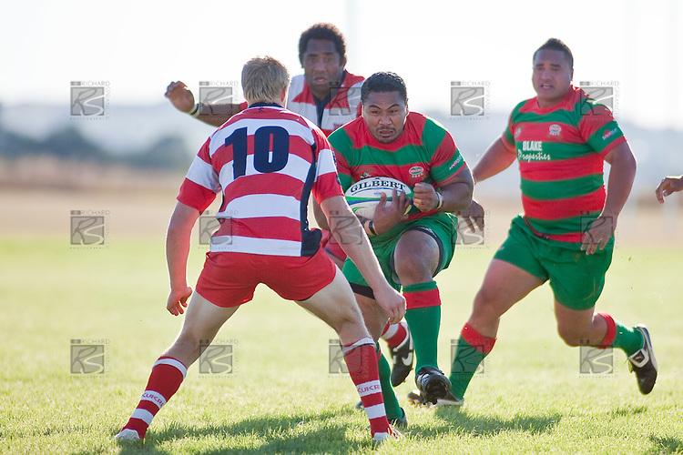 Baden Kerr braces for the impact of a charging Sosefo Kata.  Counties Manukau Premier Club Rugby game bewtween Waiuk & Karaka played at Waiuku on Saturday April 11th, 2010..Karaka won the game 24 - 22 after leading 21 - 9 at halftime.