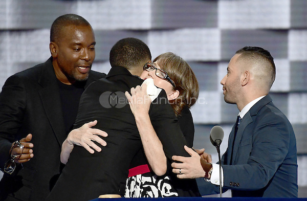 Christine Leinonen, mother of Christopher &quot;Drew&quot; Leinonen, one of the 49 victim s of the &quot;Pulse&quot; attack in Orlando, Florida, flanked by Brandon Wolf and Jose Arraigada, who are survivors of that attack, makes remarks during the third session of the 2016 Democratic National Convention at the Wells Fargo Center in Philadelphia, Pennsylvania on Wednesday, July 27, 2016.  Director Lee Daniels is at left.<br /> Credit: Ron Sachs / CNP/MediaPunch<br /> (RESTRICTION: NO New York or New Jersey Newspapers or newspapers within a 75 mile radius of New York City)