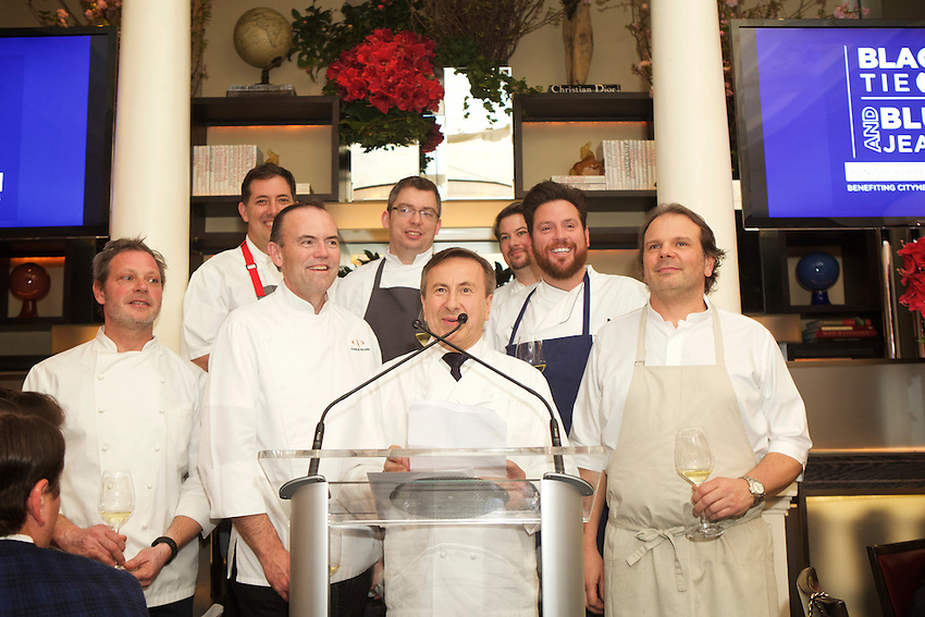 New York, NY - March 13, 2016: Chef Daniel Boulud (center), presents chefs (left to right) Frank Castronovo, Michael Anthony, Charlie Palmer, Marcus Gleadow-Ware, Ghaya Oliviera, Scott Conant and Frank Falcinelli at Black Tie and Blue Jeans, the annual Sunday Supper fundraiser at Daniel, benefiting Citymeals on Wheels.<br /> <br /> CREDIT: Clay Williams for Edible Manhattan.<br /> <br /> &copy; Clay Williams / claywilliamsphoto.com
