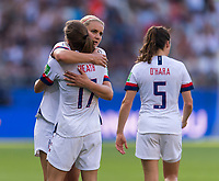 REIMS,  - JUNE 24: Lindsey Horan #9 embraces Tobin Heath #17 during a game between NT v Spain and  at Stade Auguste Delaune on June 24, 2019 in Reims, France.