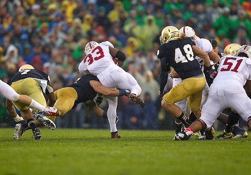 October 13, 2012:  Notre Dame inside linebacker Manti Te'o (5) makes tackle on Stanford running back Stepfan Taylor (33) during NCAA Football game action between the Notre Dame Fighting Irish and the Stanford Cardinal at Notre Dame Stadium in South Bend, Indiana.  Notre Dame defeated Stanford 20-13.